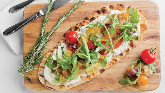 Grilled Flatbread with Ricotta Cheese, Heirloom Tomatoes, & Arugula
