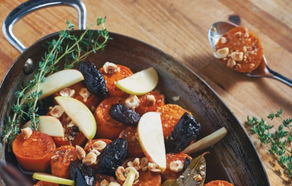 Apple Cider-Braised Sweet Potatoes with Calvados Prunes and Hazelnuts recipe